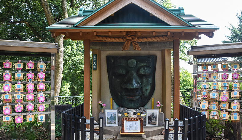 face statue at temple in japan