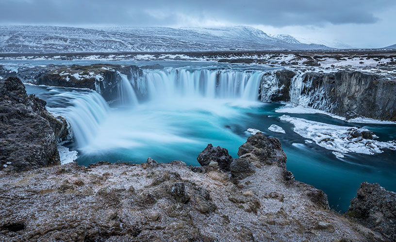 frozen waterfall in iceland during winter
