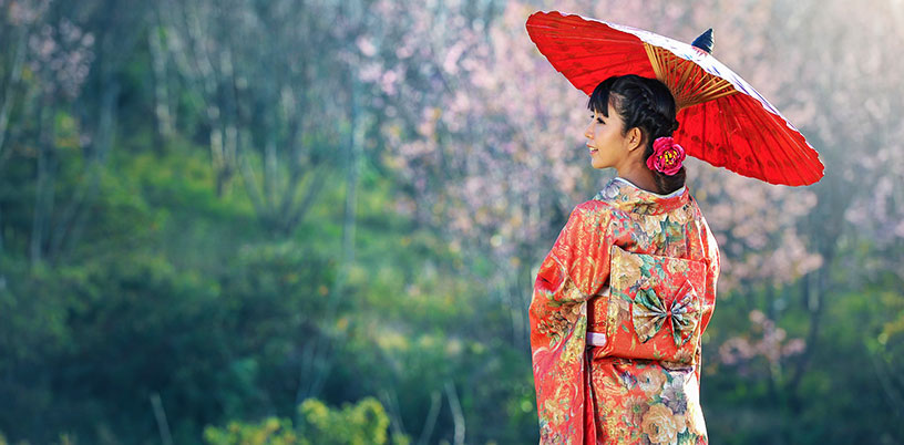 Japanese woman in kimono with paper umbrella