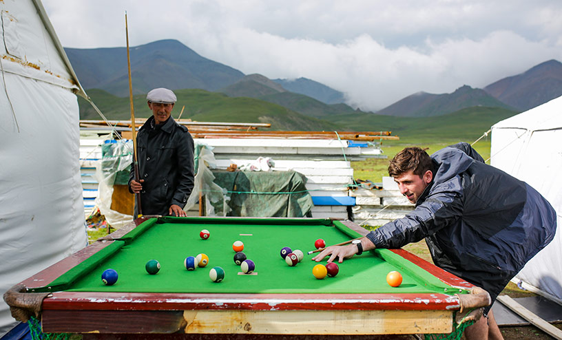 playing a game of pool in tibet