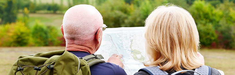 Senior couple looking at map