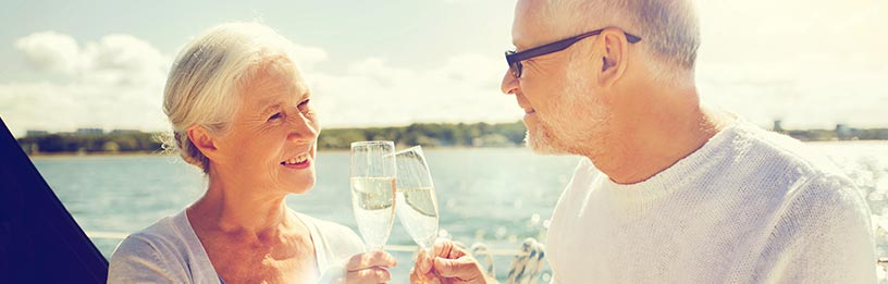 Senior couple with champagne on boat