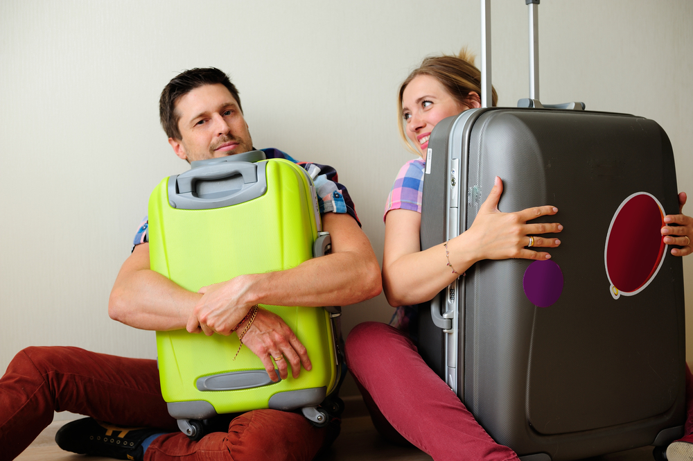 Man and Woman protecting suitcases