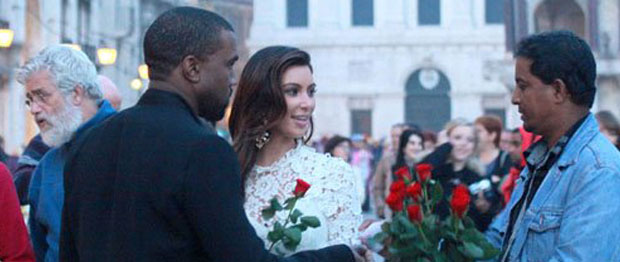 Jetsetters Kim Kardashian and Kanye West meet with a street vendor. This is the ultimate celebrity spotting photo opp.