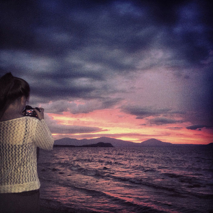Cover-More New Zealand Facebook photo competition winner: Girl watching sunset on Lake Taupo, New Zealand