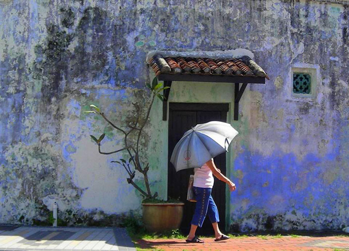 Cover-More New Zealand Facebook photo competition winner: Woman walking down a little street in Georgetown, Penang