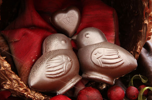 Chocolate lovebirds on display at a chocolate festival where lovers come to celebrate Valentine's Day in Terni, Italy.