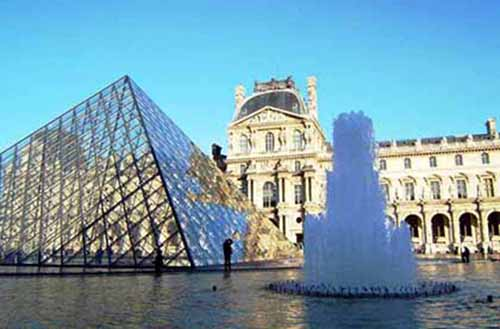 The Louvre's distinctive glass pyramid marks the entrance to one of the world's largest museums, located in Paris.