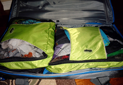 Packing cubes are a great way to match outfits and keep rolled items in the same shape and place in your luggage.