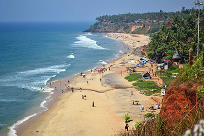 The colourful buildings and winding coastline are just a few draws of Papnasam Beach in Kerala, India.
