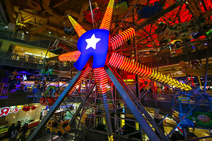 The massive ferris wheel in NYC's Toys 'R' Us gives riders a unique perspective on the immense toy store.
