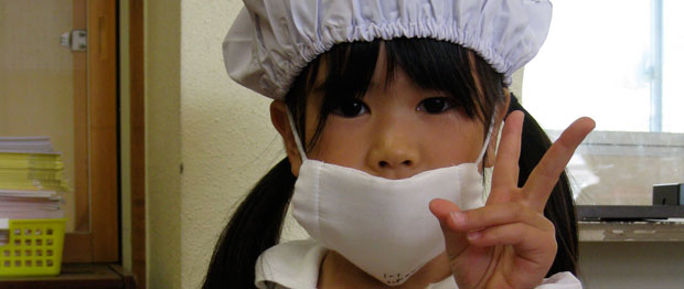 A young girl in a germ mask