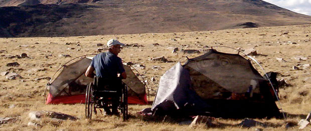 A man camps in wheelchair at Mt. White in California, USA.