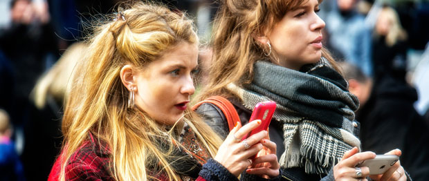 Women use their mobile phones