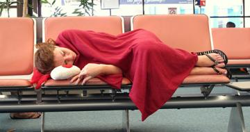 Woman asleep in airport